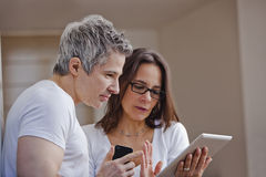 Couple looking at a digital tablet Stock Image