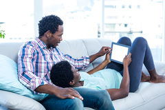 Couple looking at digital tablet Stock Images