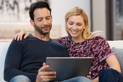 Couple looking at digital tablet Stock Photos