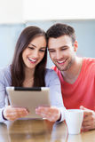 Couple looking at digital tablet Royalty Free Stock Image