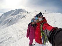 Couple looking at distance on mountain terrain Stock Photo