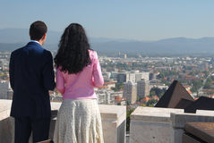 Couple looking down on main city of Slovenia - Ljubljana Royalty Free Stock Images