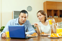 Couple looking e-mail   during breakfast Royalty Free Stock Photo
