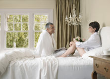Couple Looking At Each Other In Bed Stock Images