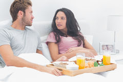 Couple looking at each other during breakfast Royalty Free Stock Image
