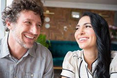 Couple looking at each other in cafeteria Stock Photography