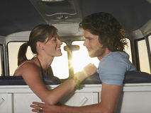 Couple Looking At Each Other In Campervan Royalty Free Stock Image