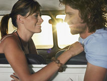 Couple Looking At Each Other In Campervan Royalty Free Stock Images