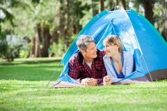 Couple Looking Each Other At Campsite Royalty Free Stock Photo