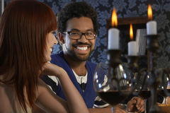 Couple Looking At Each Other At Dinner Party Royalty Free Stock Photography