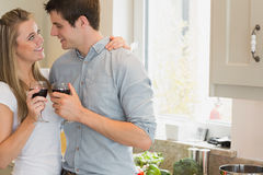 Couple looking at each other and drinking wine Royalty Free Stock Photos
