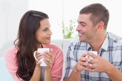 Couple looking at each other while having coffee Royalty Free Stock Photo
