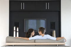 Couple Looking At Each Other While Relaxing On Couch Royalty Free Stock Photo