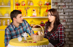 Couple Looking Each Other at the Snack Bar Royalty Free Stock Images