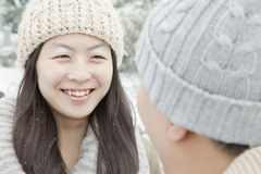 Couple looking at each other in snow Stock Photo