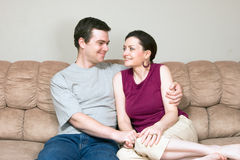 Couple Looking at Each Other on Sofa-Horiz Stock Images