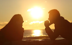Couple looking each other at sunset royalty free stock photos