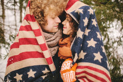 Couple looking at each other under stars and stripes rug outdoor Stock Photos