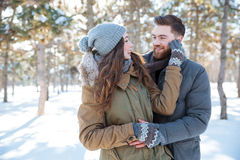 Couple looking at each other in winter park Royalty Free Stock Photography