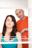 Couple looking in empty fridge Stock Images