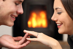 Couple looking a engagement ring after proposal Stock Photos