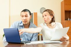 Couple looking financial documents Royalty Free Stock Image