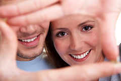 Couple looking through finger frame Royalty Free Stock Photos