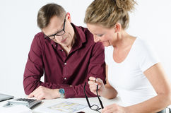 Couple looking at floor plans for new place. And calculating royalty free stock photos