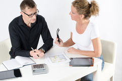 Couple looking at floor plans for new place. Discussing stock photography
