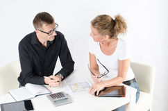 Couple looking at floor plans for new place. Discussing stock images