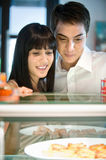 Couple Looking at Food Stock Image