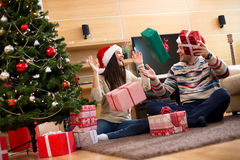 Couple is looking forward to New Year and Christmas holidays Stock Photos