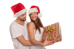 Couple looking through frame wearing Santa hats royalty free stock photos