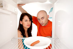 Couple looking in fridge Royalty Free Stock Photo