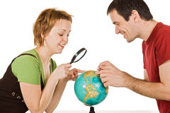 Couple looking at globe Royalty Free Stock Images