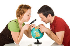 Couple looking at globe Royalty Free Stock Image