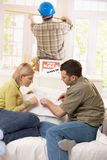 Couple looking at ground plan of new house Royalty Free Stock Images