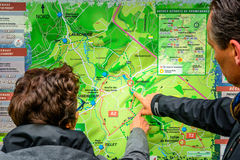 Couple looking on hiking map Stock Photo