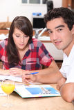 Couple looking at holiday brochures Stock Photography