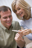 Couple looking at home pregnancy test Stock Photos