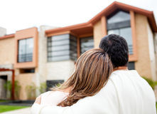Couple looking at a house Royalty Free Stock Photography
