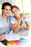 Couple looking at house blueprint Royalty Free Stock Photos