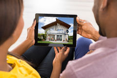 Couple Looking At House Stock Photo