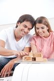 Couple Looking at House Model Stock Photography