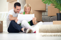 Couple looking at house plans Stock Photo