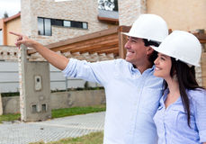 Couple looking at houses Stock Image