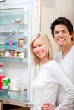 Couple looking inside the fridge Stock Photos