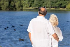 Couple looking at lake Stock Image