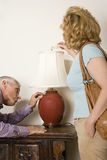 Couple looking at lamp Royalty Free Stock Photo