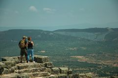 Couple looking the landscape from wall of Castle. Monsanto, Portugal - July 13, 2018. Couple looking the countryside landscape from stone wall at the Castle of stock photography